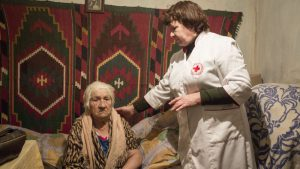 A URCS nurse/health visitor Natalia Babenko checks Raisa Onyschenko in Semyonovka village, near Sloviansk, Donetsk area.